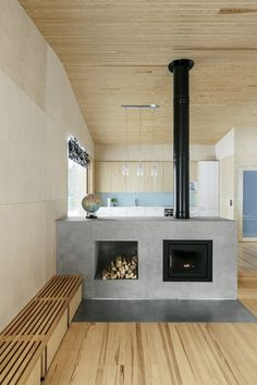 Black Home by Playa Architects  - Fireplace