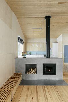 Black Home by Playa Architects  - Fireplace