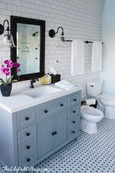 Master Bathroom Reveal - Parent's Edition - The Lilypad Cottage Master Bathroom Decor - love the tile and those pendents!<br> Master Bathroom Decor Ideas, beautiful blue and grey marble bathroom. Grey Marble Bathroom, Bathroom Floor Tiles, Bathroom Renos, Small Bathroom, Bathroom Ideas, Bathroom Vanities, Bathroom Cabinets, Bathroom Storage, Remodel Bathroom