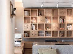 Apartments:Glamorous Modern Apartment: Natural Wood Design Stunning Cool Wooden Bookshelves Includes Drawers White Couch Coffee Table Wooden Desk And Chairs Grey Sofa With Pillows White Wall Paint Wooden Floor