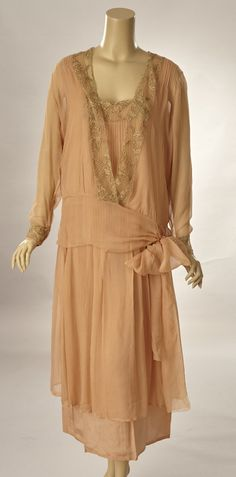 1920s Beautiful peach silk Georgette dress with matching over blouse. The sleeveless dress is drop-waisted and has a deep scoop neckline is front bordered with lace. The lace is ivory with the pattern outlined in brown embroidery floss. The lace is used to highlight the neckline on the dress and cuffs on the blouse along with the blouses neckline and right and left center front sides. Both center front and center back, on the dress, are set with fixed pin tucks. Front