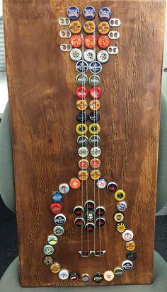 Bottle cap art guitar Diy Bottle Cap Crafts, Beer Cap Crafts, Bottle Cap Projects, Cork Crafts, Bottle Top Art, Beer Cap Art, Recycled Crafts, Corks, Blue Guitar