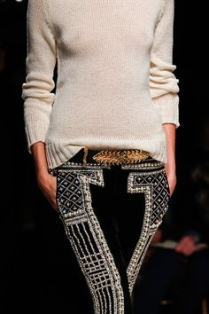Plain sweater unique belt & cool pant with a print or pop of color or print.