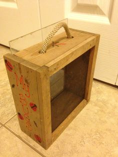 My Bug Box: frame made w/4 pieces of wood sized to however big you wish your box to be. Stapled a piece of screen on one side and slid a piece of plexiglass on the other.  Customizable with paint pens.  Stapled a piece of rope cording to carry.