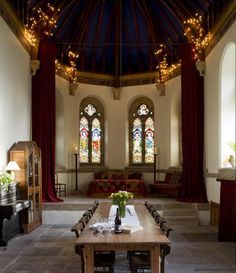 Old Church conversion.  Ingenious idea to highlight the eaves with lights!  It brings the entire space into balance and highlights the gorgeous ceiling!