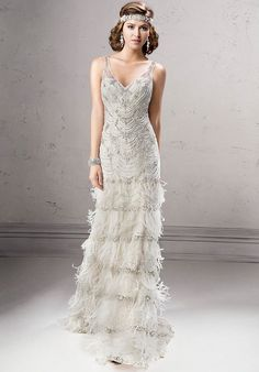 Gatsby inspired artistry makes a statement in this sheath, complete with embellished V-neckline, tiered feather skirt and glittering Swarovski crystals. Finished with crystal button and zipper back with inner elastic closure.