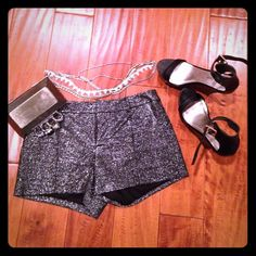 "Dressy ""Connie"" shorts from Guess Black and shiny with silvery sparkle, these dressed up Guess shorts originally retailed at Bloomingdales for $79. Waist is 15 inches flat across. Length just shy of 11 inches and inseam measures 3 inches. Perfect for when you're feeling a little ""cheeky"". Dress then down with a t shirt or go full glam with heels. Guess Los Angeles Shorts"
