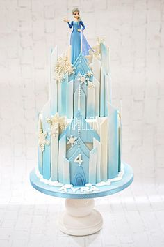 Frozen themed castle cake with Elsa toy figure Elsa Birthday Cake, Frozen Themed Birthday Cake, Themed Cakes, 4th Birthday, Frozen Party Cake, Frozen Castle Cake, Frozen Fondant Cake, Pastel Frozen, Elsa Cakes