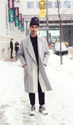 I love the cut of the grey overcoat.
