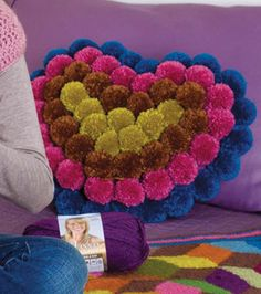 Heart Shaped Pom-Pom Pillow  Skill Level: Some experience necessary Crafting Time: Over 5 hours Skill Level: Some experience necessary
