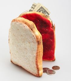 """Peanut Butter and Jelly Pouch/Change Purse, $14.00, Carry your fave sandwich everywhere with this handy faux PB pouch. The photo-real fabric makes it look totally yummy! Each sandwich half makes a roomy zippered pouch--open it up to see the peanut butter n' jelly halves, which stick together with a magnetic closure. Man made material. This tasty pouch measures 4.5""""x5"""""""