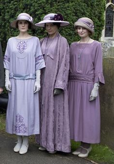 Seen in full-length, we can appreciate how far Downton fashion has developed since the show began in 1912.    Note the rising hems (both Lady Mary and her sister are showing their ankles, an unthinkable act just 10 years before) and the lowering waist bands, plus an injection of seasonal colour and Lady Edith's fabulous cloche hat.