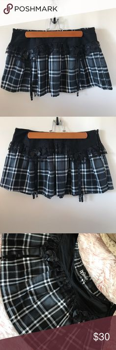 Plaid Lip Service mini skirt Super cute black and white plaid skirt by Lip Service. Lace ruffle detail with satin bows and four garters! Side zipper closure. Metallic silver threading adds the perfect touch of glimmer. This is excellent quality, NWOT and never worn. No modeling or trades Lip Service Skirts Mini