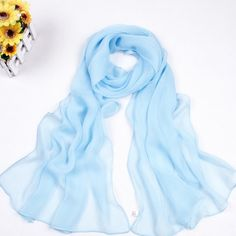 2 for $18 Chiffon Scarves / Shawls  2 Versatile Chiffon Scarves   Scarves are always versatile for any season. You can layer both together; or utilize it as a shawl, sarong wrap, swimsuit cover up, sitting, etc.; it's always a good idea to keep one in the car, in case of cold weather; or fashion emergencies  Quantity: 2  Colors: White / Sky Blue  Measurements: 21x60 Material: 100% Polyester Manufacturer's packaging  Must Have Necessity. Accessories