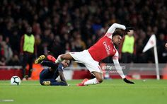 Alex Iwobi of Arsenal is tackled by Ashley Young of Man Utd during the Premier League match between Arsenal FC and Manchester United at Emirates Stadium on March 2019 in London, United Kingdom. Get premium, high resolution news photos at Getty Images Ashley Young, Doubledown Casino, Man Utd News, Free Slots, Premier League Matches, Arsenal Fc, Manchester United, Running, Fun Games