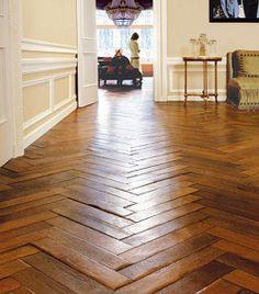 Rustic wooden herringbone floors.