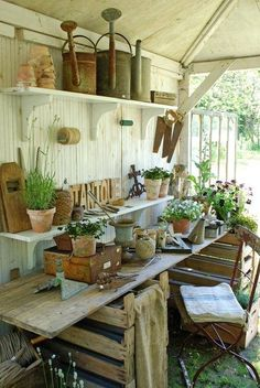 Potting shed made from recycled pallets, so cute you would spend all your spare time here - #GardenPallets