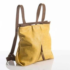 The Ani Fold Yellow Backpack is a medium-sized carrier made of fabric with sturdy walnut leather straps. This backpack is conveniently accessed and practical for every day usage to store personal items. Satchel Backpack, Diaper Bag Backpack, Canvas Backpack, Laptop Backpack, Travel Backpack, Brown Leather Backpack, Leather Shoulder Bag, Yellow Backpack, Travel Bags