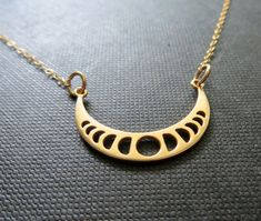 Natural golden bronze moon charm showing each phases. 14k gold filled fine chain. Celestial jewelry  Moon charm-33x16.5mm