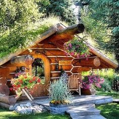 Living roof on this little log cabin and lots of flowers. Relaxshacks.com: THIRTEEN Tiny Dream Log Cabins- AND a floating log home! | Tiny Homes