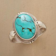 Turquoise Matrix Signet Ring  Impressive oval cabochon of richly matrixed turquoise is framed in an oxidized silver bezel atop a polished sterling silver band.