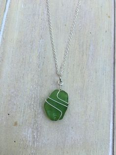 Short silver colored necklace with green seaglass pendant