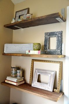 Reclaimed wood shelves with industrial metal brackets