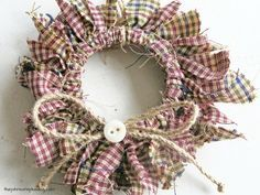 Love this idea of using a mason jar lid ring to make a mini wreath ornament ! DIY Homespun Fabric Christmas Ornaments - Click through for detailed tutorial for 4 different kinds of DIY Christmas ornaments. They make great handmade Christmas presents! Primitive Christmas Decor } Rustic Christmas Decor | Primitive Christmas Ornament