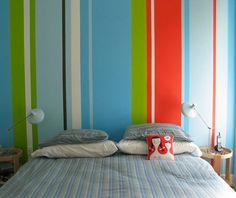 "Sneak Peek: Best of Rainbow. ""Instead of a headboard, Shelley Goldberg painted a colorful striped mural on her bedroom wall."" #sneakpeek #rainbow"