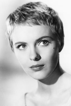 If we were to list the most iconic pixie haircuts, Audrey Hepburn, Jean Seberg and Mia Farrow would be at the top. These film and fashion stars sported t. Jean Seberg, Layered Pixie Cut, Pixie Cut Blond, Long Pixie, Wavy Pixie, Asymmetrical Pixie, Pixie Styles, Short Hair Styles, Rihanna Pixie