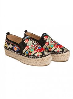 Catopsia Espadrille Give your feet a little taste of the Southwest with the Johnny Was CATOPSIA ESPADRILLE. Featuring a bold embroidery design of feathers and graphic patterns, this warm-weather slip-on is gorgeous. With classic stylings like a braided platform made from a natural jute and a traditional blanket stitch around the edge, this laid-back classic is ready for spring.   —Polyester blend top —Jute platform —Rubber sole —Slip on style —Elastic strips on either side —Care…