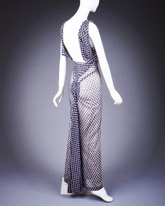 The sheer fabric of Schiaparelli's 1935 evening dress lends it an ethereal quality, the elliptical blue print falling into a variety of folds & with an interestingly constructed square back Gown Gallery, Sheer Fabrics, Ethereal, Evening Dresses, Polka Dots, Museum, Gowns, Clothing, Blue