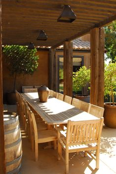 The dining area in the backyard is shaded by an arbor built out of reclaimed timbers. Description from houzz.com. I searched for this on bing.com/images