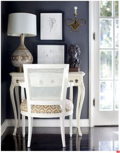 love the deep blue walls with the bright white furniture and high gloss floors