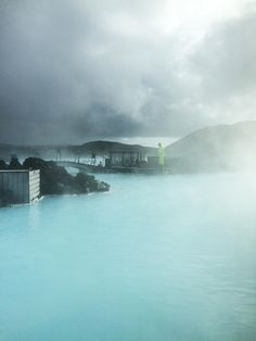 """Trip to Iceland-"""" Submerged, the almost unbearably hot water engulfs my body, lapping over my floating limbs and filling my ears with an eerie calm. I languish in the bitter odorous smell of silica and sulfur; the minerals keep me afloat, bobbing and swirling with the eddies and tides. I take in the stark, black volcanic mountains around me. it is easy to forget I am on planet Earth."""" – excerpt of Alex Winston's Icelandic Journey"""
