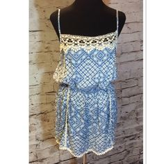SZ LG % RAYON GORGEOUS ROMPER WITH LACE DETAIL This romper is so pretty and girly with beautiful detail and adjustable straps. JUNIOR SIZING Shorts