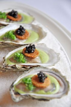 Auberge du Pommier - Huîtres & Caviar poached oysters, domestic caviar, leek velouté & toasted brioche by Chef Marc St. Jacques - photo by Allison Woo