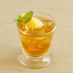 Apple-Spiced Iced Tea | Turn classic iced tea into seasonal fare. Apple juice, cinnamon sticks, and vanilla bean create a taste reminiscent of cider. | SouthernLiving.com