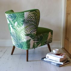 Date: Note: This cocktail chair displays a very tropical pattern of fabric. The green works well with the darker wooden legs. Upholstered Furniture, Upholstered Dining Chairs, Cuddle Chair, Wooden Armchair, Cocktail Chair, Headboard Decor, Eames Chairs, Home And Deco, Living Room Chairs