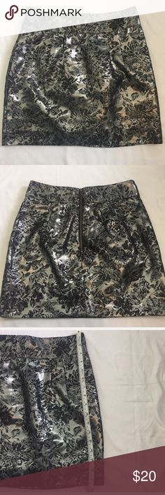 🎀3 For $30 Urban Outfitters Metallic Skirt Size 8 Urban Outfitters Silence +Noise silver metallic skirt. Floral print. Back zipper. Good used condition. No rips or stains. Size 8. Length approximately 17 1/2 inches. 40% cotton/30%polyester/30% acrylic silence + noise Skirts Mini