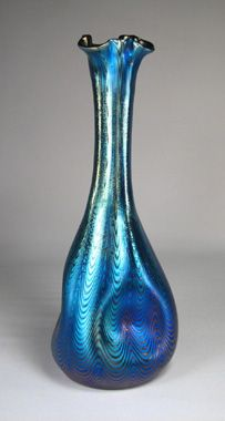 Loetz Rubin phanomen (soliel fleur)__outstanding free form vase with extremely rich platinum blue iridescence on a red ground Source:  google