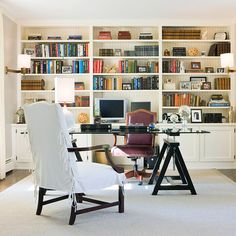 To give office shelves an organized feel, gather a wide variety of collectibles and place them between books, creating loose symmetry.