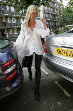 Kate Moss in a white bohemian blouse, leggings, and knee-high boots