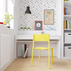 Above the built-in desk is a fun polka-dot paper. A black pendent stands out against the print and helps illuminate the desk for late-night reading. Yellow Playroom, Colorful Playroom, Kids Workspace, Kid Desk, Built In Desk, Girls Bedroom, Lego Bedroom, Childs Bedroom, Kid Bedrooms