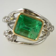 Emerald and diamond hand-crafted dress ring