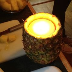 Core a pineapple and add a candle!! Soo cute ad great for Hawaiian parties! Credit: ambers mom
