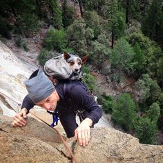 Dean climbing with h