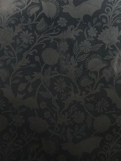 Stunningly detailed wallpaper depicting venus flytraps, bats, and thorned vines. It's called Elysian Fields. While I like the somber Licorice color best, I would giggle to see this in the Antique pink or the blue-china looking Cobalt.