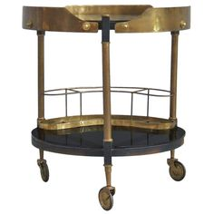 Italian Brass Bar Cart | From a unique collection of antique and modern bar carts at https://www.1stdibs.com/furniture/tables/bar-carts/