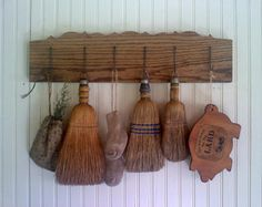 peg shelf with whisk brooms